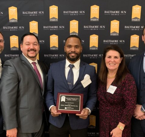Best Places Photo – holding award